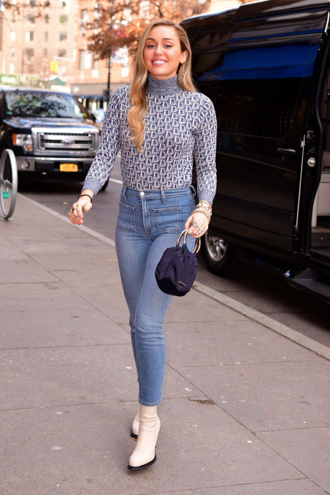 080000ab56ead Miley Cyrus steps out in a Dior Sweaters and Reformation Jeans ...