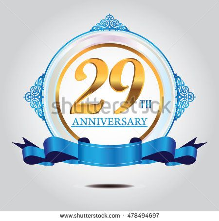 29th anniversary golden logo with soft blue ring ornament and blue ribbon