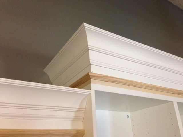 Idea for how to elevate current bookshelves tutorial on for Attaching crown molding to kitchen cabinets