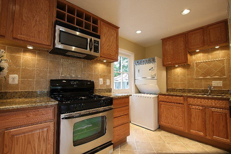 kitchens with oak cabinets and stainless steel appliances ...