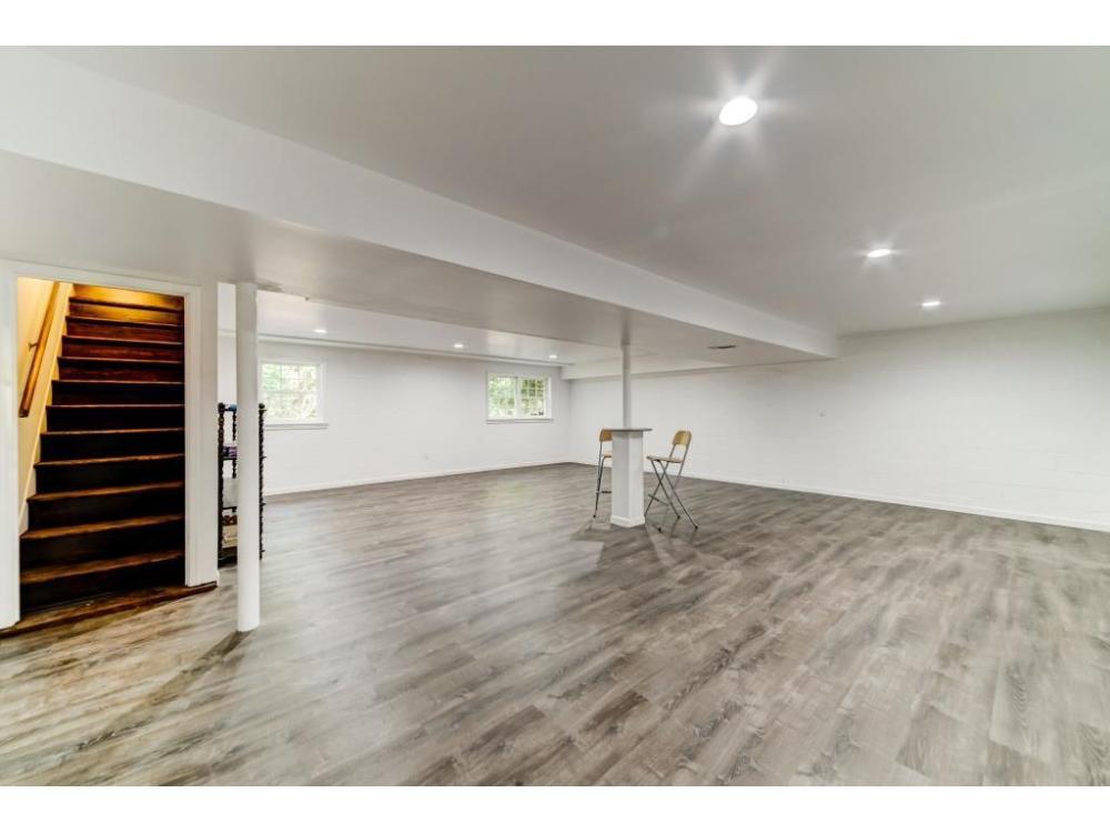 Finish half basement with luxury vinyl flooring. Remove