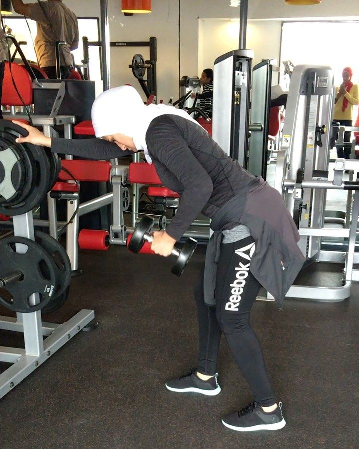 The dumbbell row is an upper body back exercise that can increase overall strength and muscle mass o...