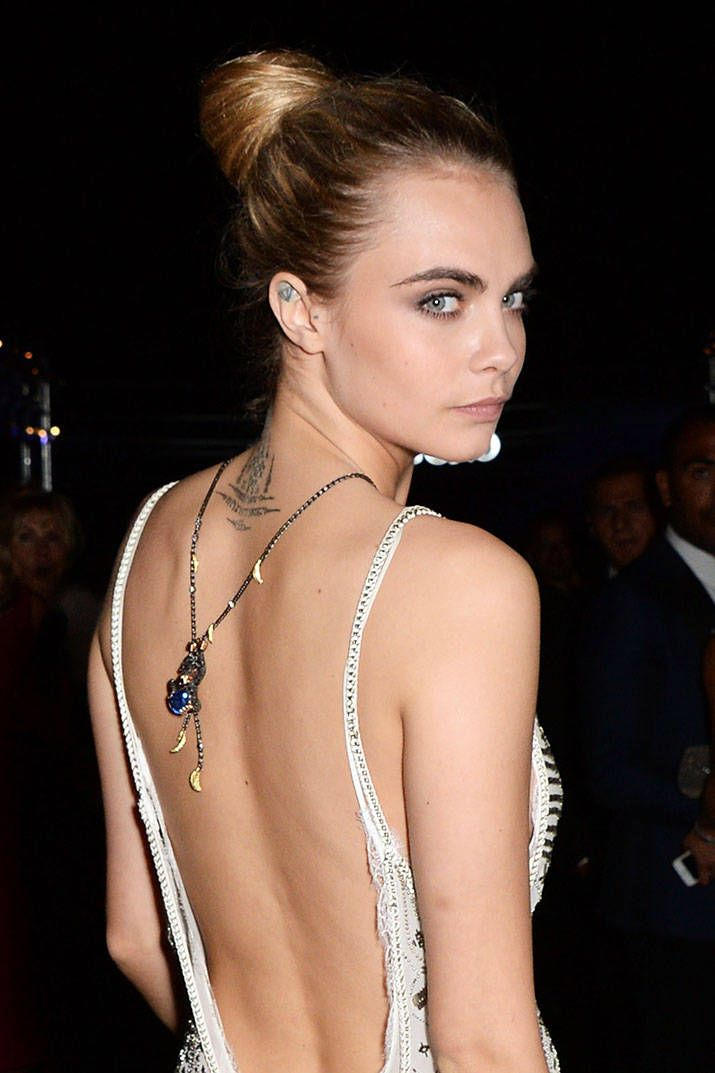 Cara Delevingne wore her De Grisogono jewels tossed over her shoulder. Click here to see jewelry designer Ilana Ariel's lookbook featuring delicate chain necklaces layered and worn backwards.