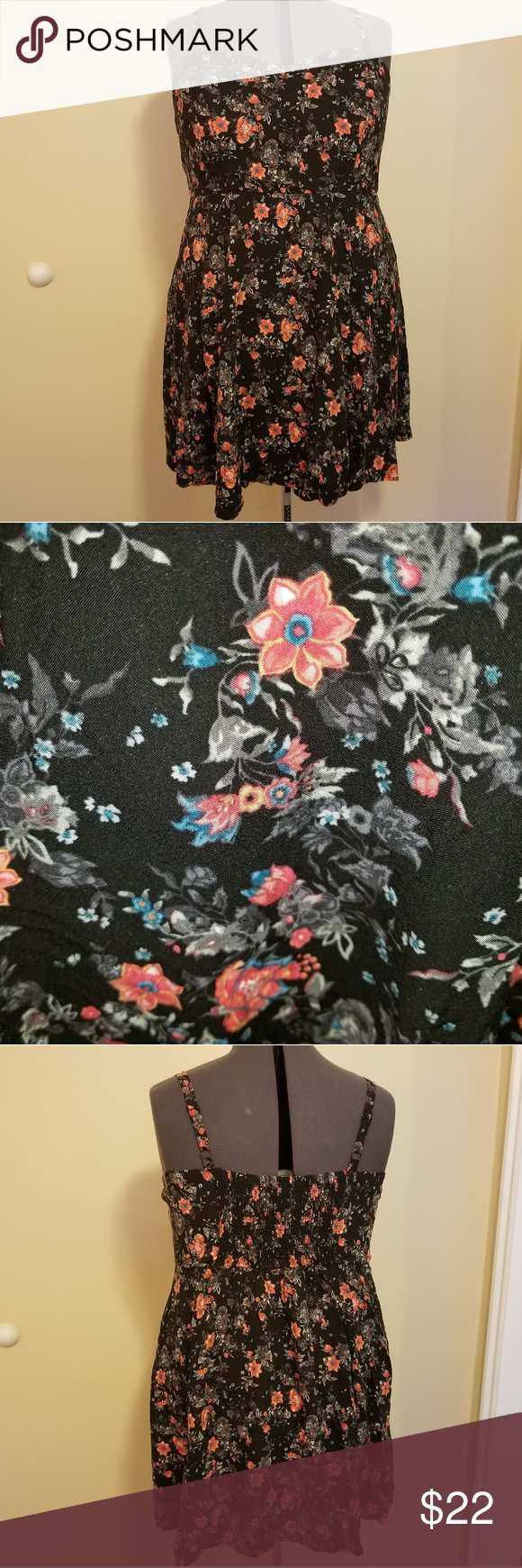 Torrid floral short sundress Excellent condition.  Worn twice.  Unfortunately I'm a bit too tall for this...especially for summer activities!   Has stretch back for the perfect fit. torrid Dresses Mini #shortsundress