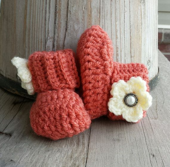 Crochet baby girl boots, in salmon with cream flower and pearl button center. size 0 to 3 mo.