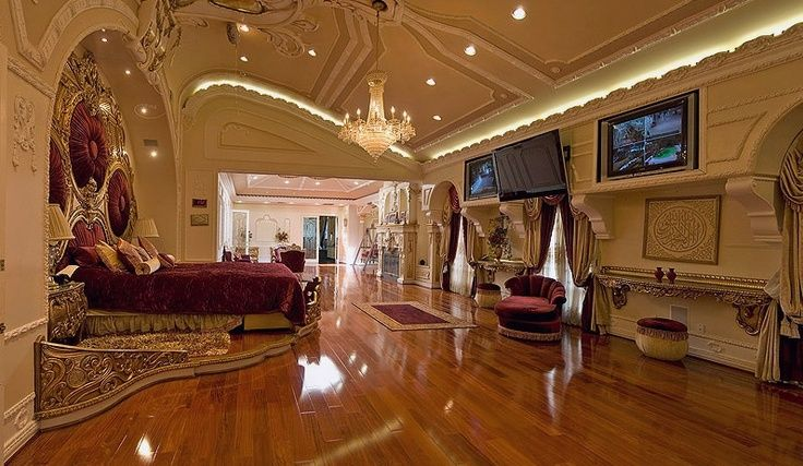 this sumptuous master bedroom is eye catching and the epitome of luxury and greatness