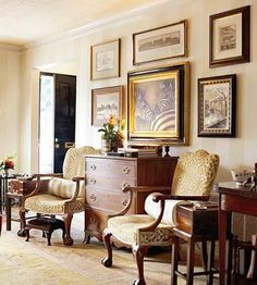 British Colonial Living Room Grounded By A Pair Of George III Style Chairs Side Tables Black Door For Contrast Wall Art