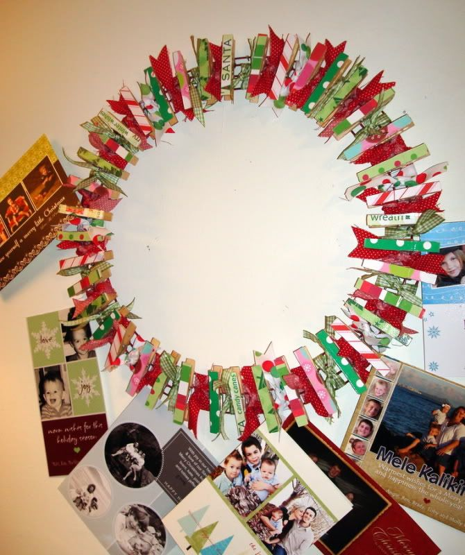 Christmas card wreath. Cute. May try spray painting the clothes pins ...