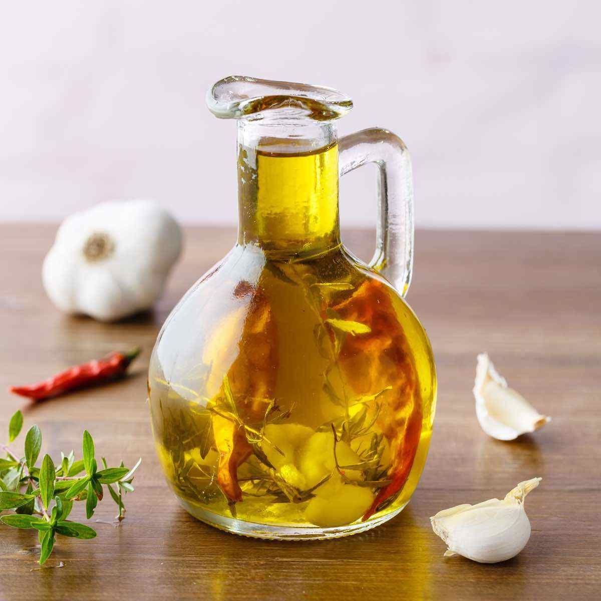 How To Make Garlic Infused Olive Oil Good With Everything Recipe Garlic Infused Olive Oil Infused Oil Recipes Olive Oil Recipes