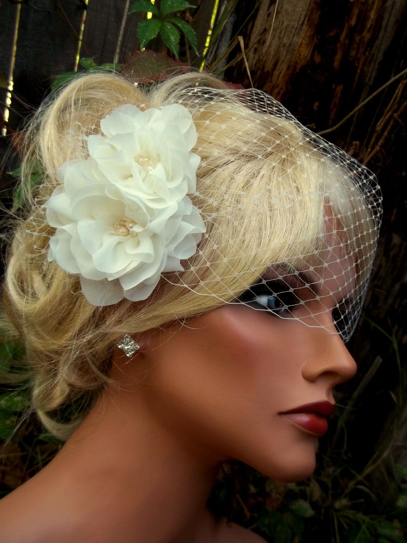wedding hair flowers with small birdcage bridal veil