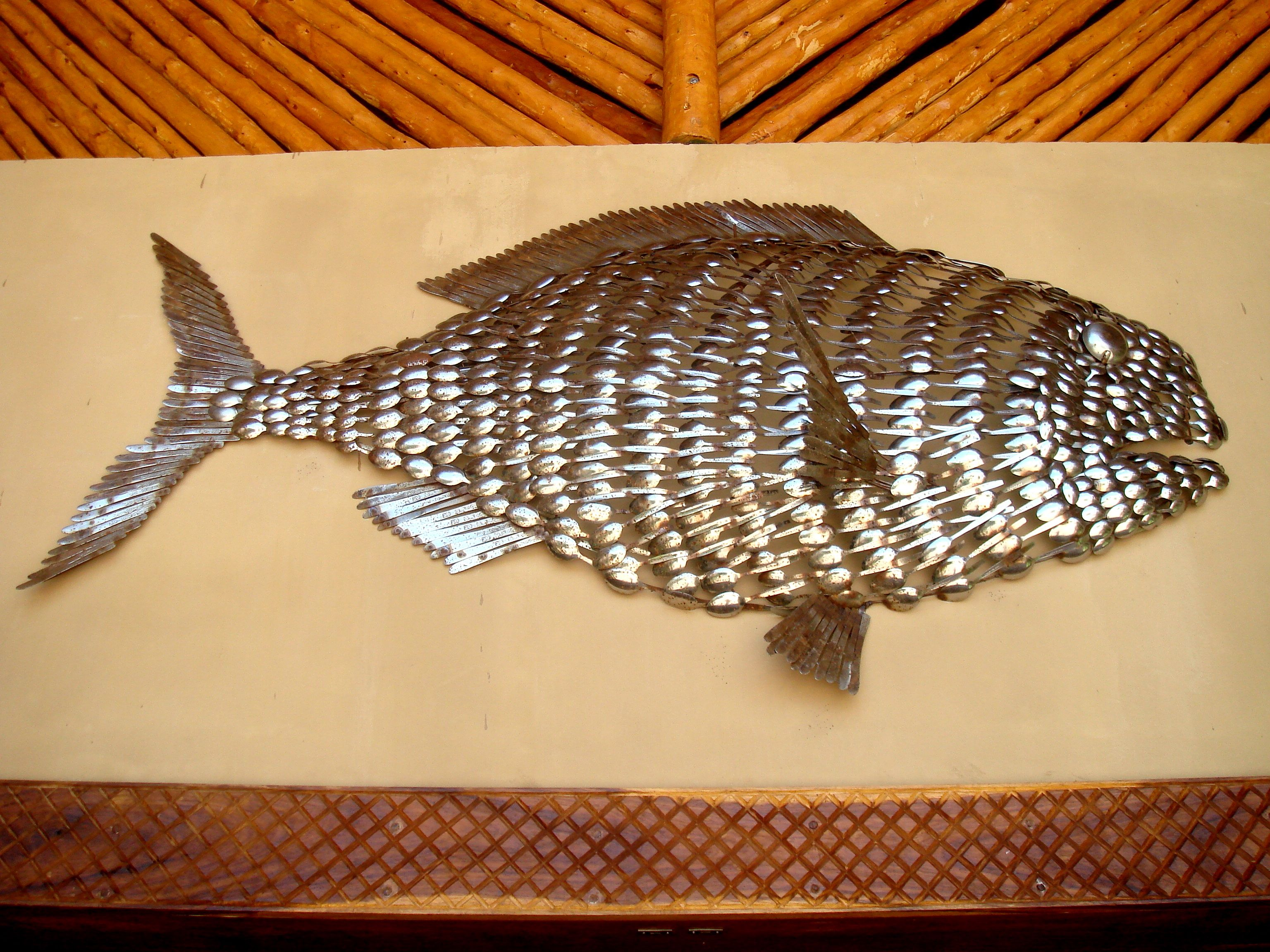 Wall decoration at Azura Benguerra is a handmade fish, made out of ...