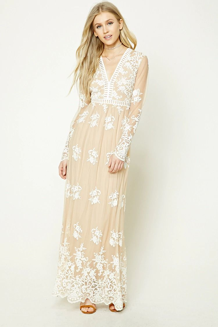 A mesh maxi dress featuring allover floral and baroque inspired