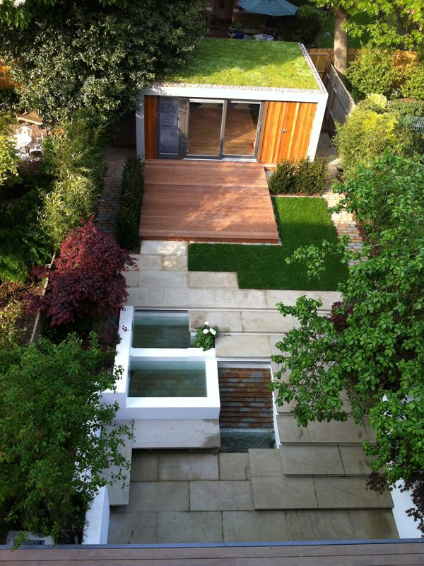 A Garden On Different Levels With A Studio Home