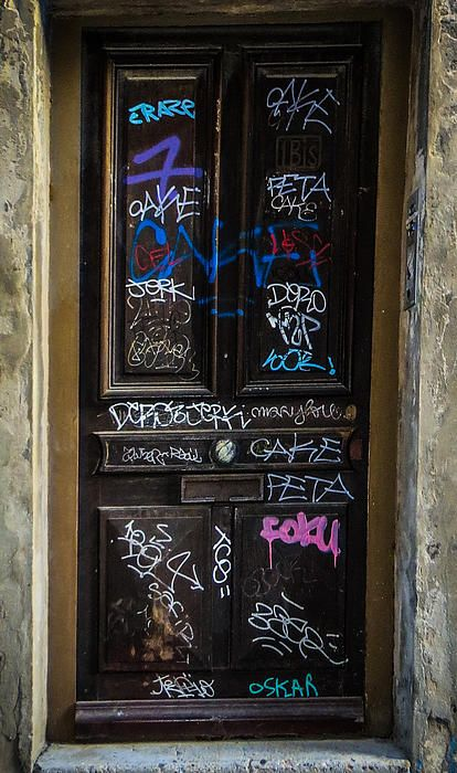 Ooh La La! Graffiti entry door in France. Interesting.....