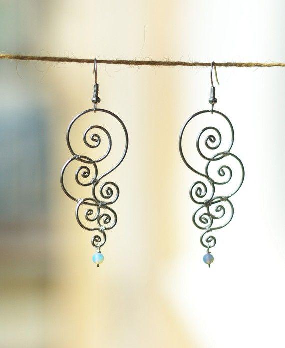 Silver Curles  earrings by SabiKrabi on Etsy, $0.30