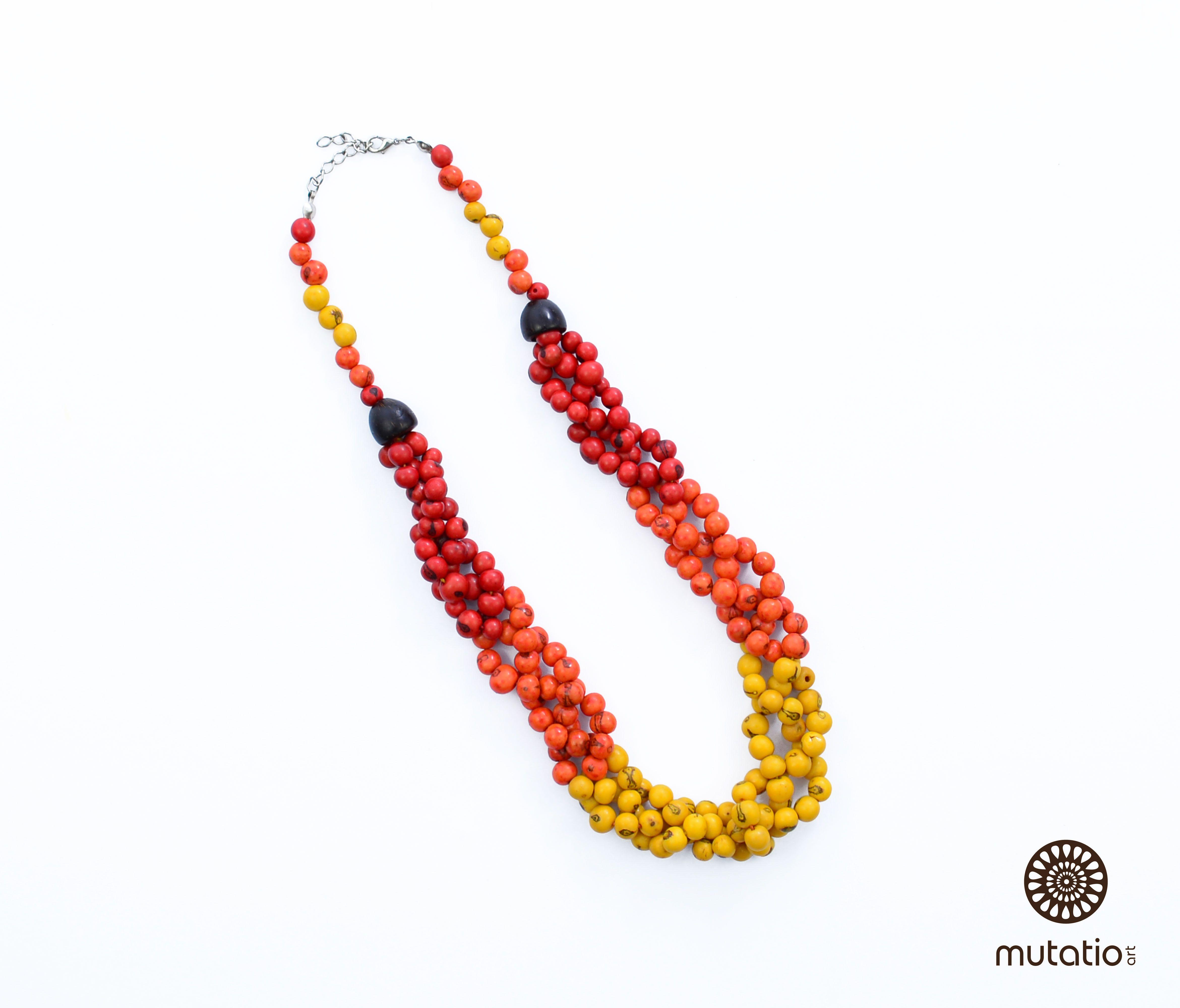 Colar Trançado Açaí (Cores Quentes) #acessorios #colar #biojoia #biojewels #fashion #eco http://www.elo7.com.br/colar-trancado-acai-cores-quentes/dp/4DAF3C