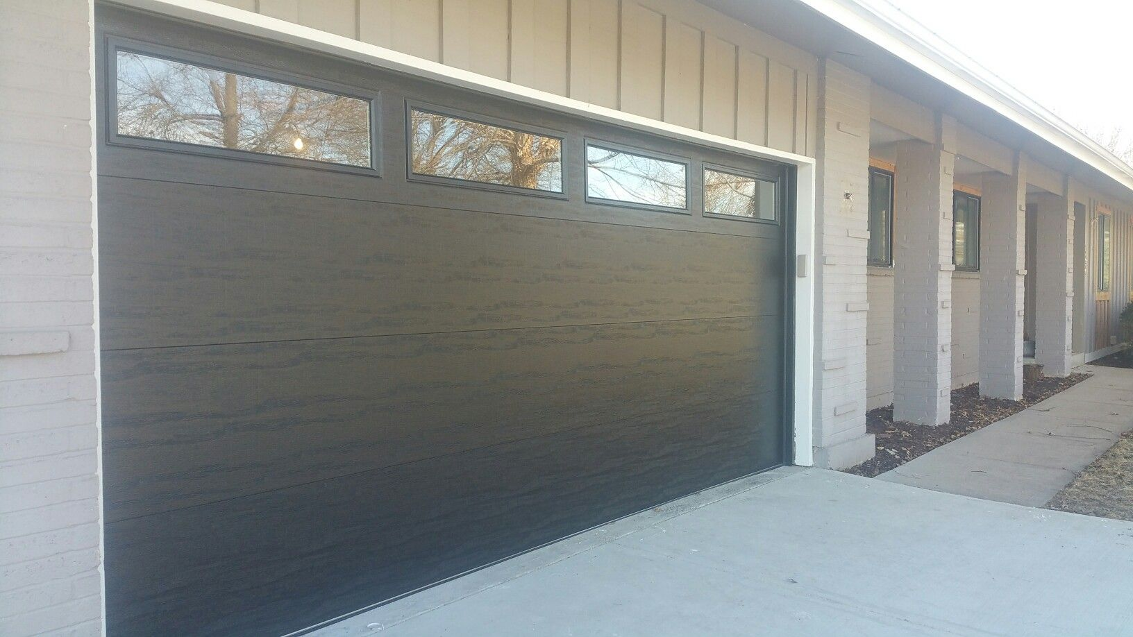 16x7 Clopay 4051 Black With Plain Lites Lake Winnebago Mo Door Installation Outdoor Decor Doors