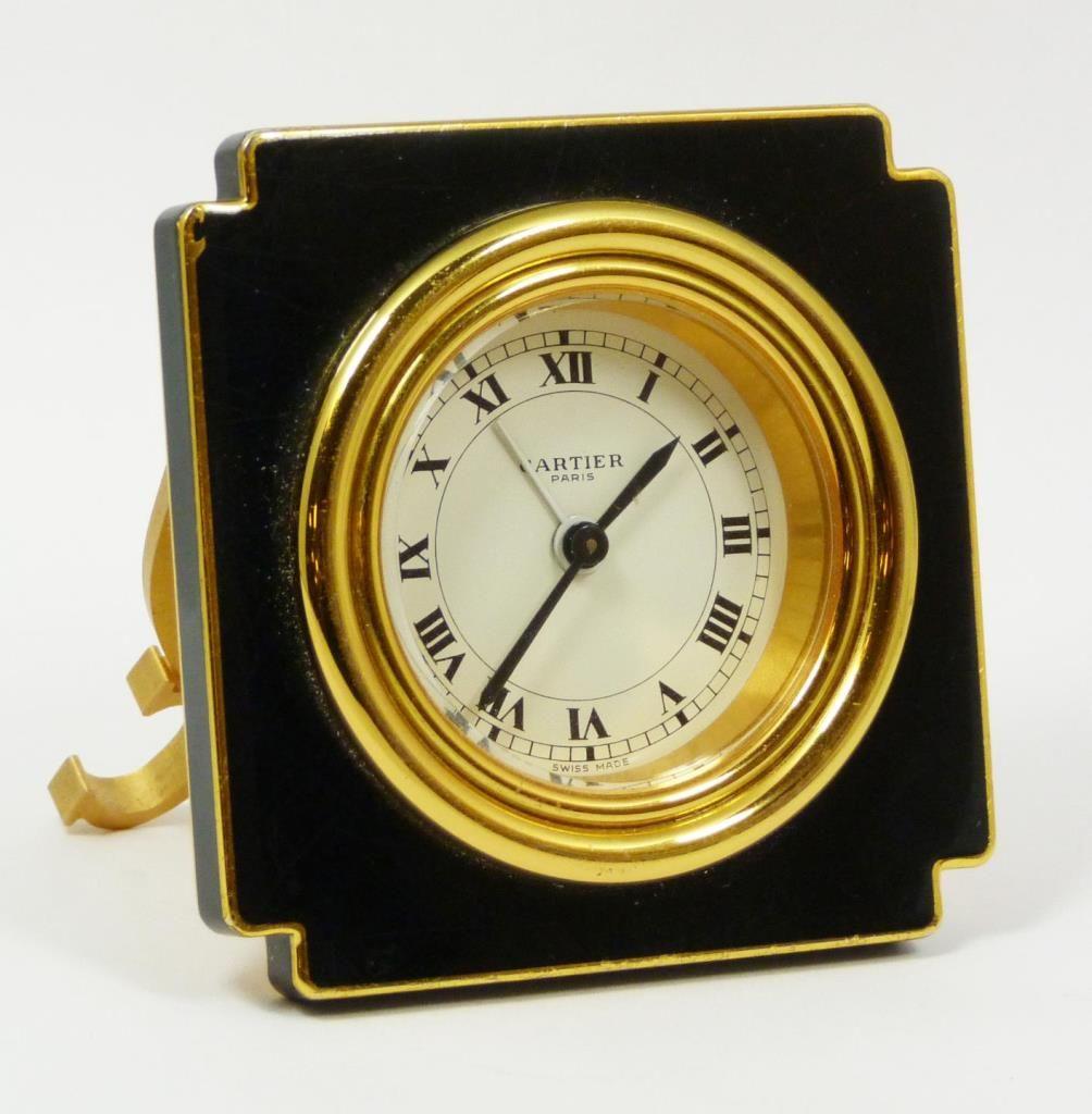 Les Must de Cartier French enameled desk alarm clock having a white ...