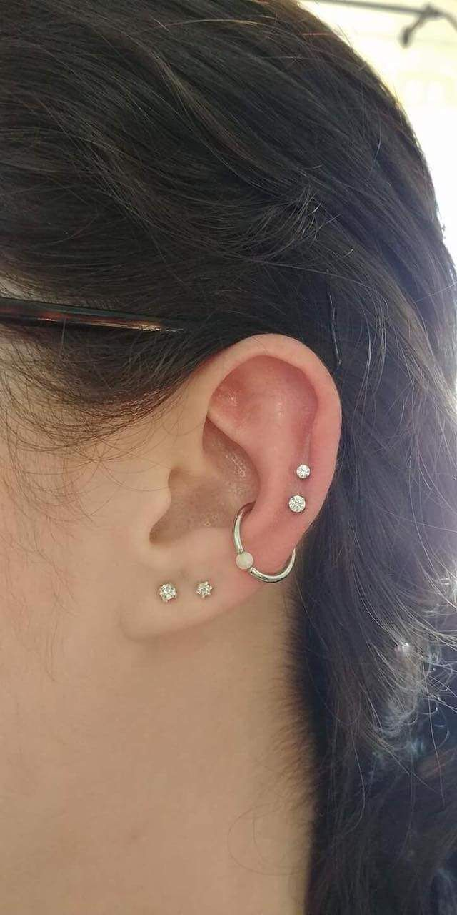 Upper nose piercing   Adventurous Ear Piercings That Are Up On the Trend  Piercing