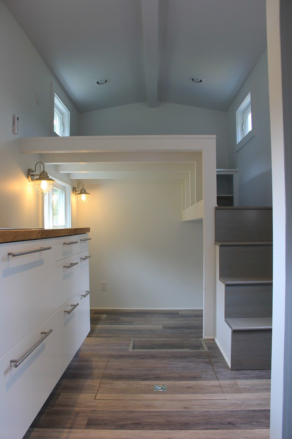 A tiny house with 2nd loft used as closet area and soaking tub ...