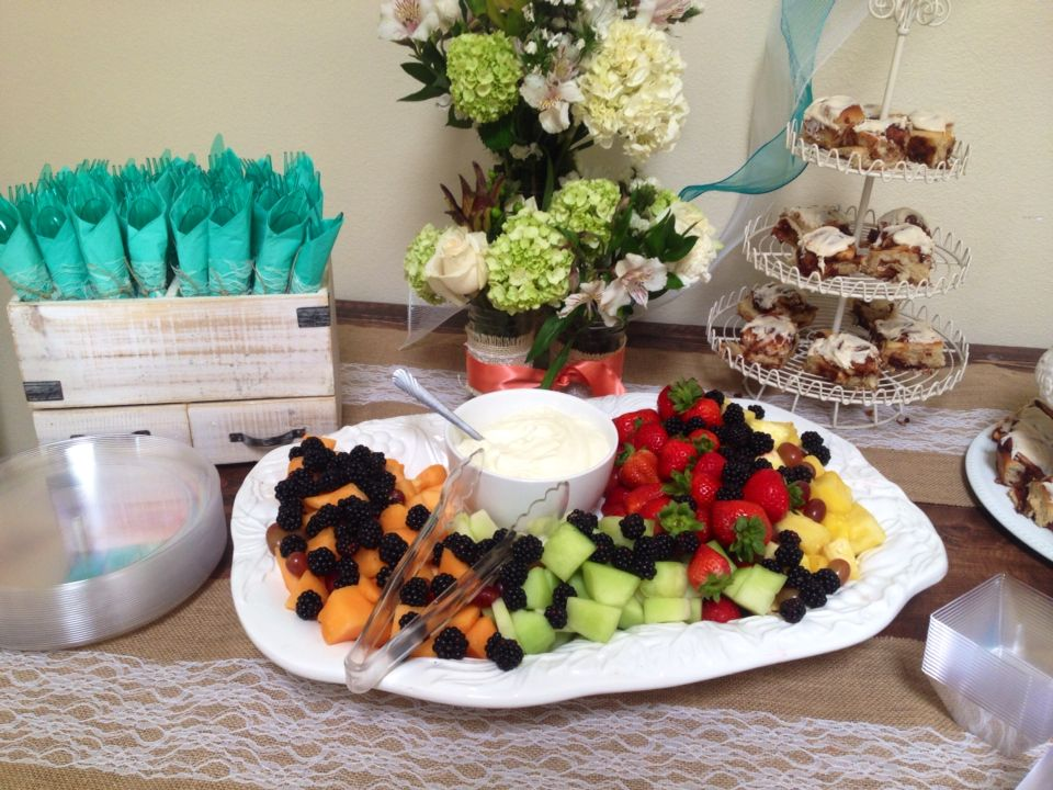 Baby shower for my sister n law. Coral and teal theme. Food table. Fruit platter with fruit marshmallow and cream cheese dip.