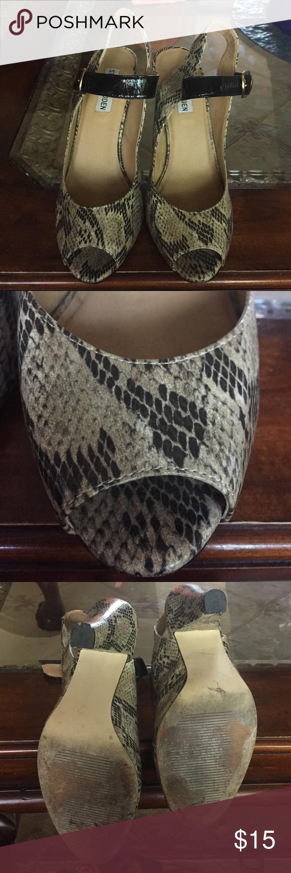 Steve Madden snakeskin heels Snakeskin heels by Steve Madden. Black shiny buckle. 4 in heel. I always take offers! =) Steve Madden Shoes Heels