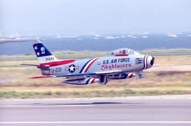 A North American F-86 Saber makes a low pass.
