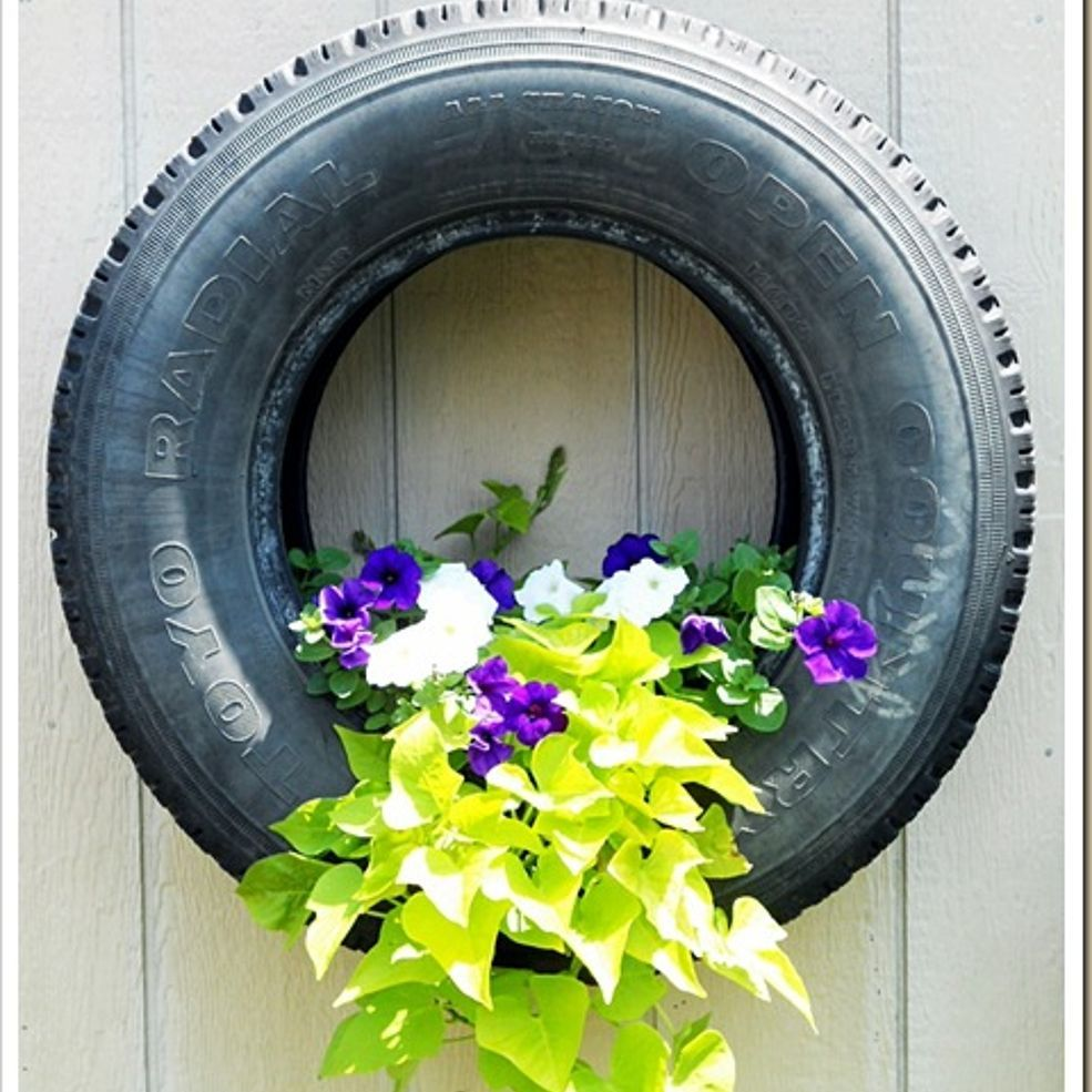 Garden decor with tyres  New Craze Old Tire Planters  Tire planters Planters and Gardens