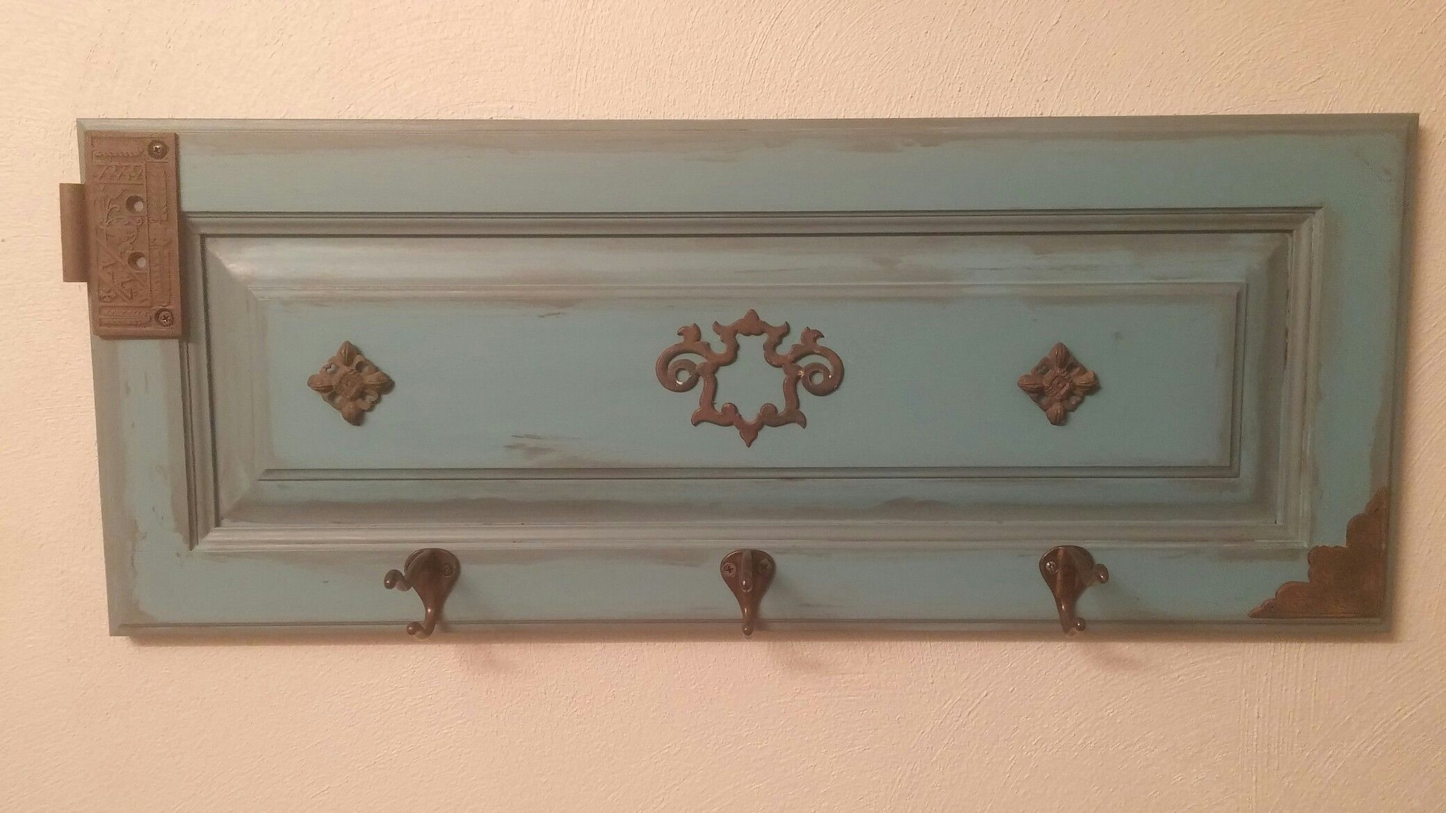 Repurposed cabinet door. Chalk paint. Vintage, brass fixtures. One of my favorite things I've ever made!