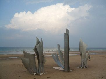 Normandy, France is first on my wish list of places to visit. My grandfather was in the first wave of soldiers to land at Omaha Beach on D-Day. He was one of the few survivors in that first wave to land.