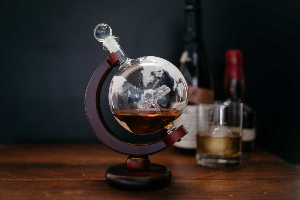 Display your whiskey in an etched world globe whiskey decanter