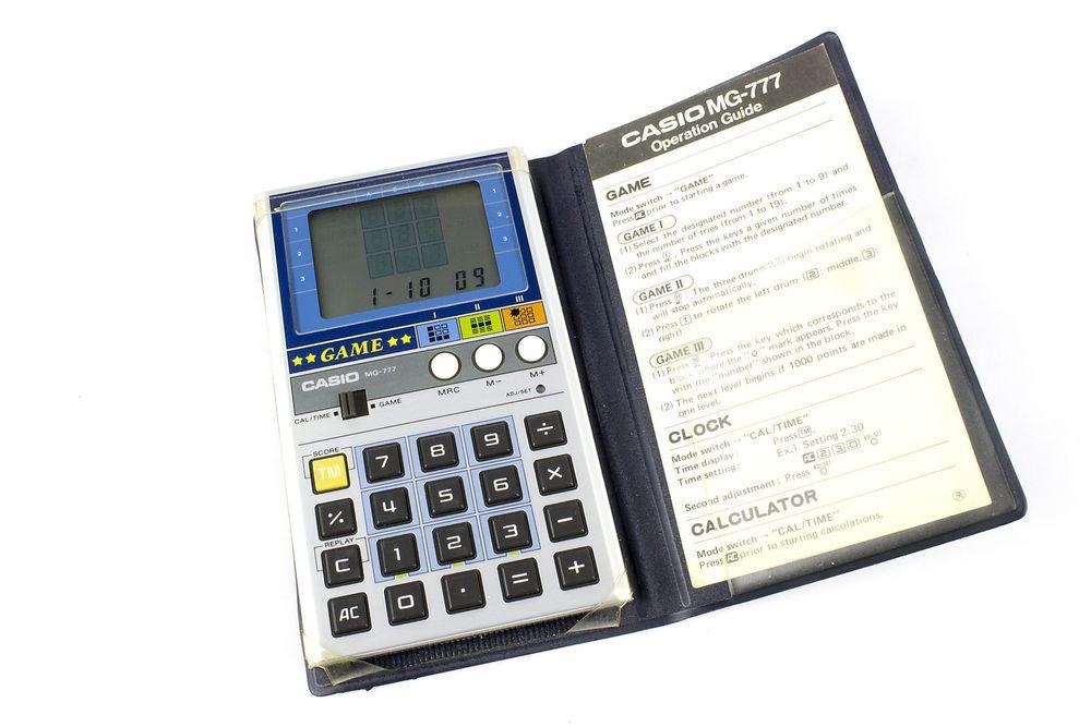 Vintage Handheld Electronic Casio MG-777 Calculator / Game