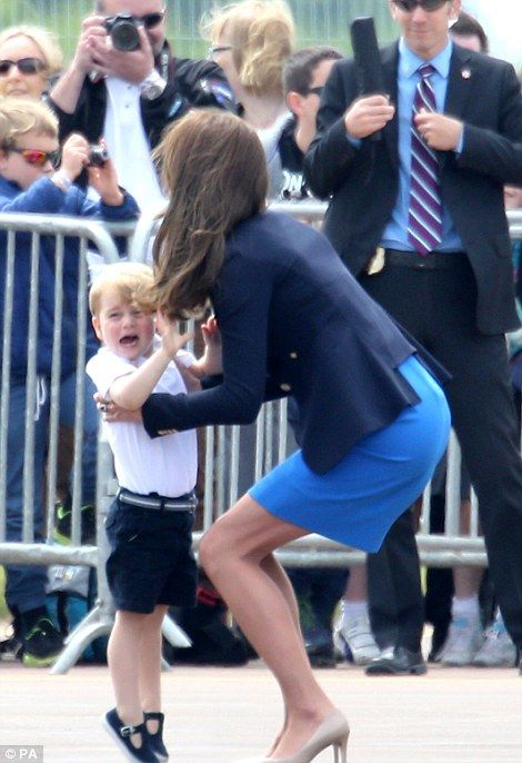 Prince George stole the show as he joined his parents for a fun day out at a military air show