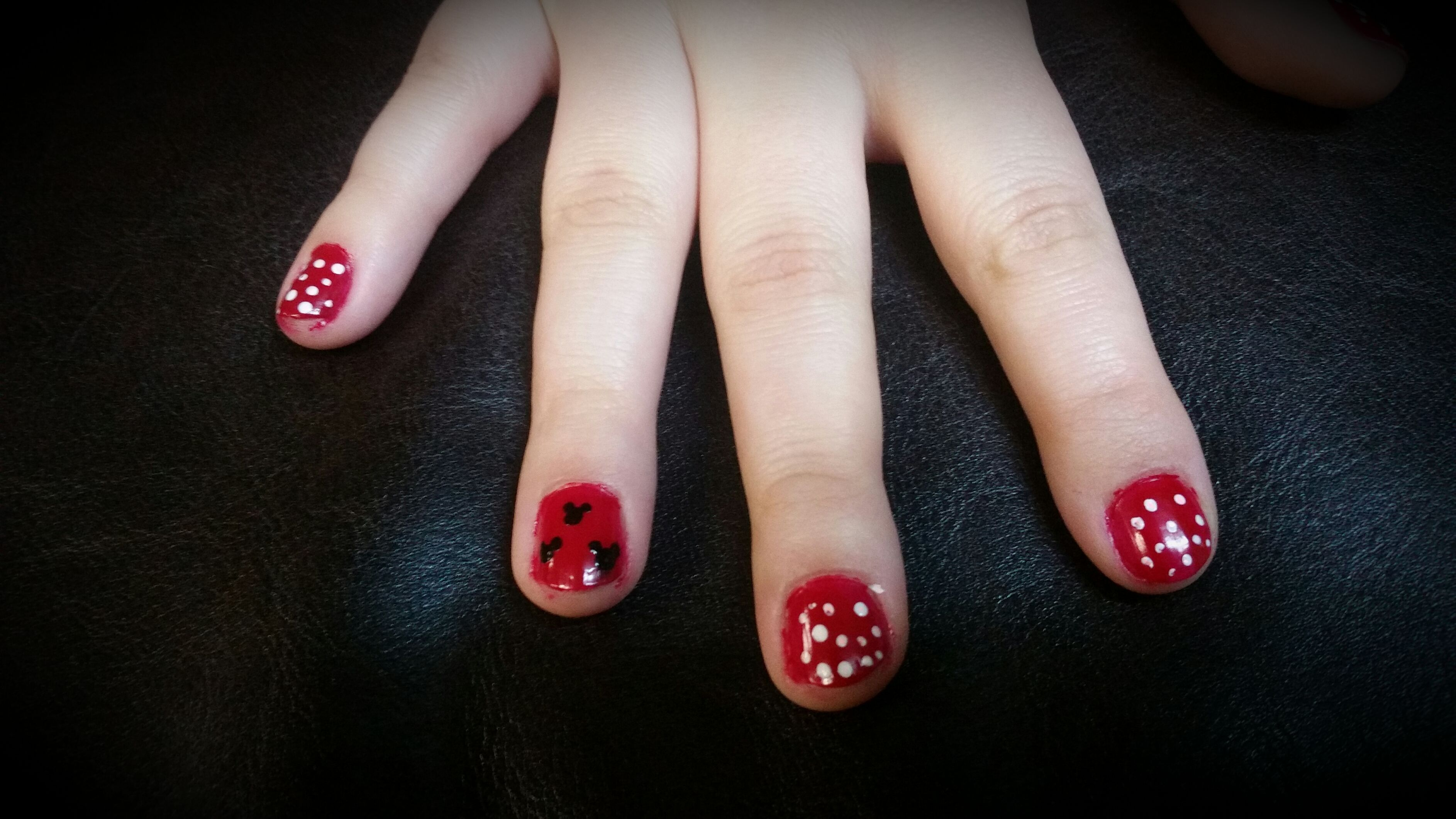 Inspired by Minnie and Mickey, this design is simply a red background with polka dots and Mickey heads done by a bobby pin
