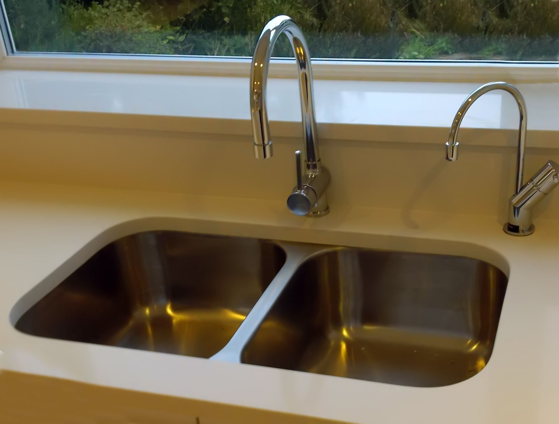Cheap Kitchen Sink And Tap Sets this customer has set the bluci rubus 3535u into a corian type