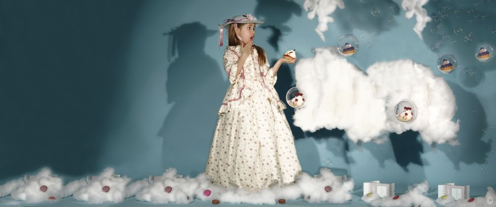 Little princess lost in a dream of La Durée Macarons