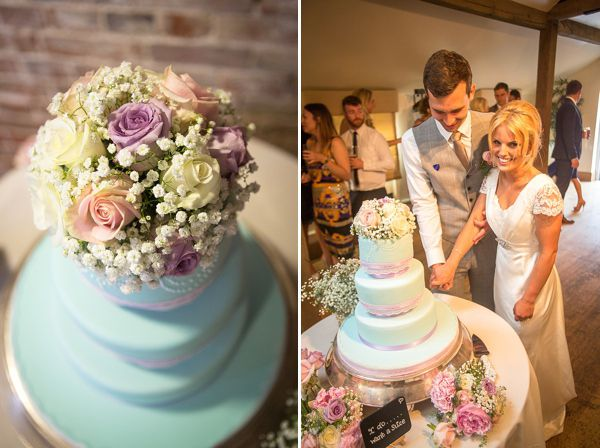 """""""We had a rounded 3 tier, duck egg blue colour with Lilac ribbon and lace wrapped around each tier. We had a topper made from our florist to tie in with the rest of our flowers."""""""