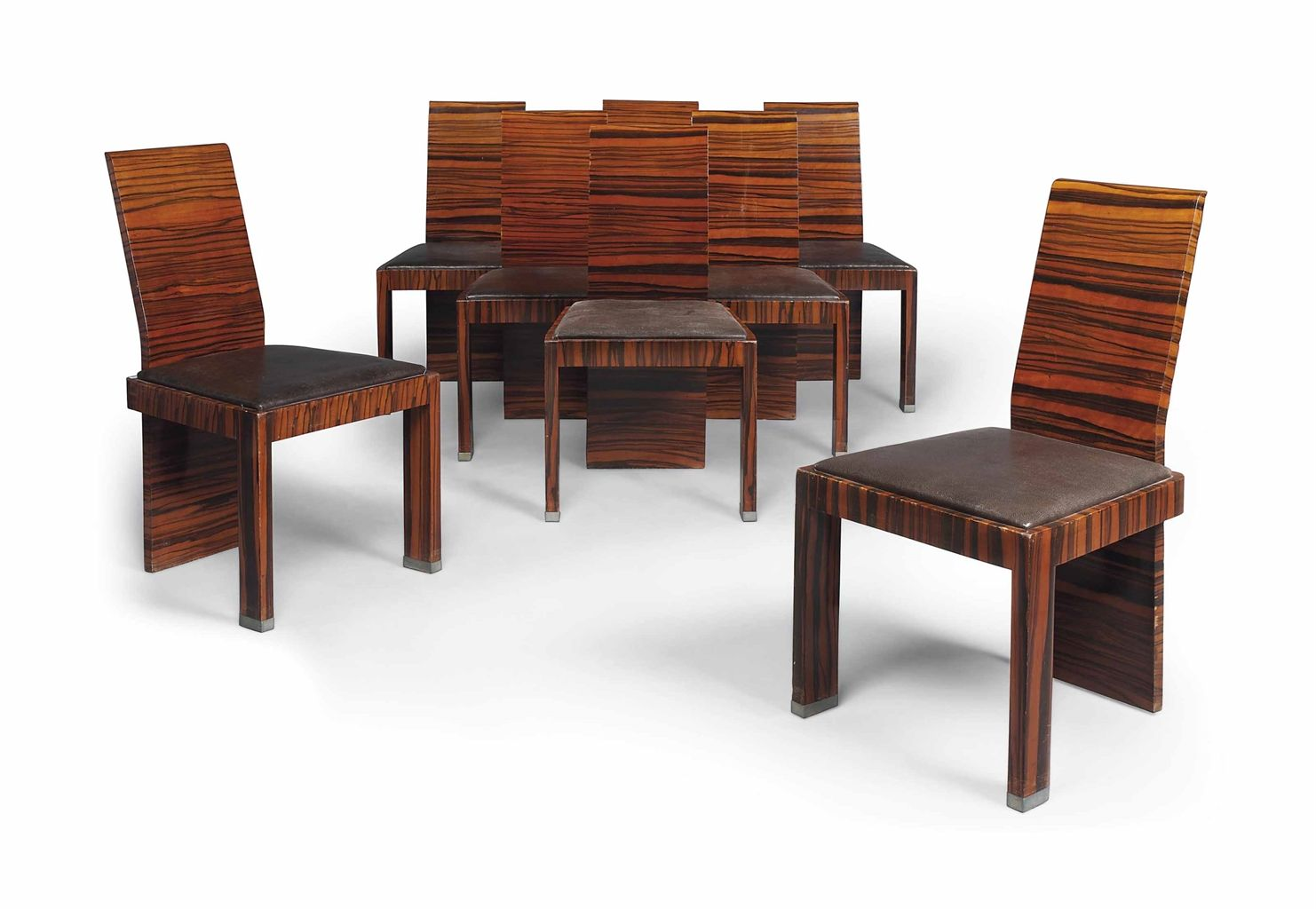 A SET OF EIGHT ART DECO MACASSAR EBONY DINING CHAIRS  CIRCA 1930