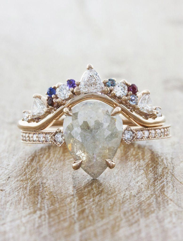 This is a photo of Tempest: Intricate Wedding Ring with Trillion & Round Diamonds