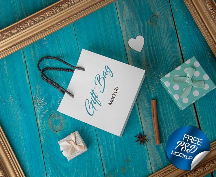 Download Gift Bag On Wooden Blue Background Mockup Bag Mockup Mockup Free Psd Free Gifts