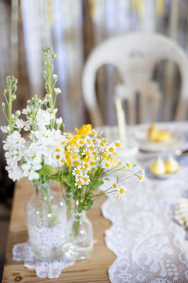 Create a rustic wedding theme with a summery burst of yellow & lace.