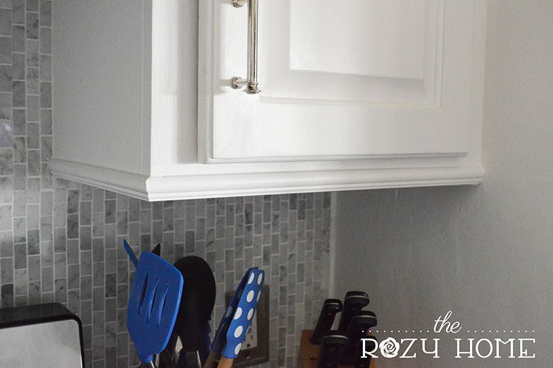 Easy And Inexpensive Cabinet Updates The 15 Minute Fix Adding Trim To The Bottom Of Cabinets The Rozy Home Update Cabinets Kitchen Cabinets Trim Cabinet Trim