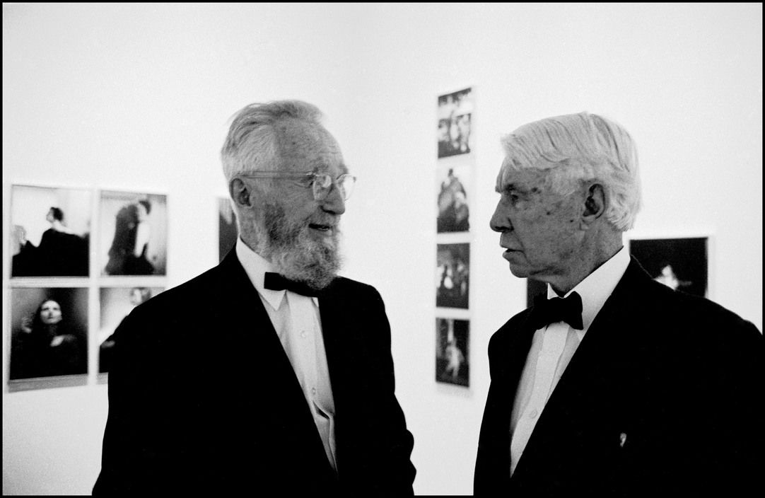 Bob Henriques USA. NYC. 1961. Edward Steichen and his brother in law, Carl Sandburg at a party being held for the former at the Museum of Modern Art.