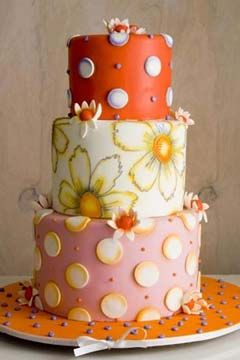 Three tier pink, white, orange and yellow 1960's inspired wedding cake. Decorated with polka dots and flowers. From www.thecakegirls.com    ........   #wedding #cake #birthday