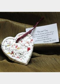 "Blooming Expression Embossed Heart Favors are personalized favors that bloom when planted!  Each favor is handcrafted in the USA of 100% recycled cotton fiber, fresh flowers and perennial wildflower seeds.  Your guests will enjoy it as a decoration, then may plant it in 1/4"" to 1/2"" soil, keep moist and watch it bloom!  All Blooming Embossed Heart Favors include a personalized (with names and date) standard verse on a White Tag and choice of raffia color tie. Minimum quantity 50+.    View…"