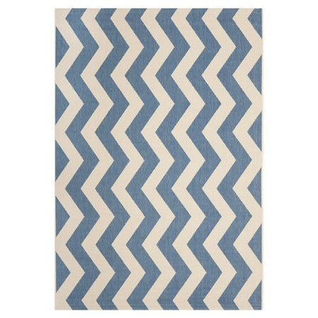 8bc270b2115 Bring visual appeal to your den or define areas in the living room with  this indoor outdoor rug