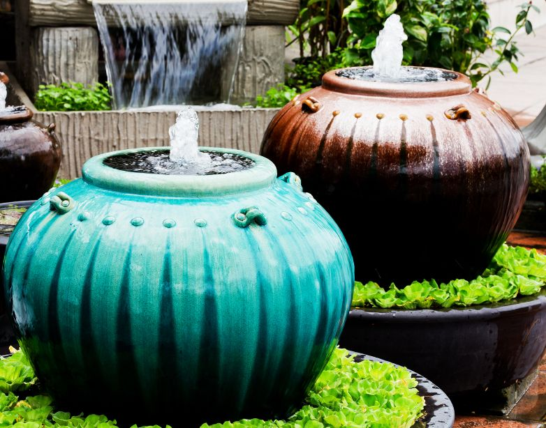 11 Amazing Water Fountains Made From Planters