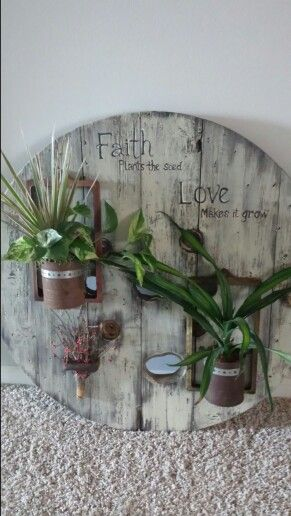 Spool planter made with old rusty cans and tractor license plates for frames. #cablespooltables