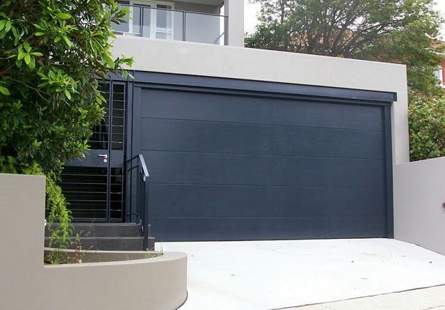 Black Roller Garage Door Modern Garage Door And Gates Https Www Pinterest Com Avivbeber3 Modern Garage D Garage Door Design Modern Garage Doors Garage Doors