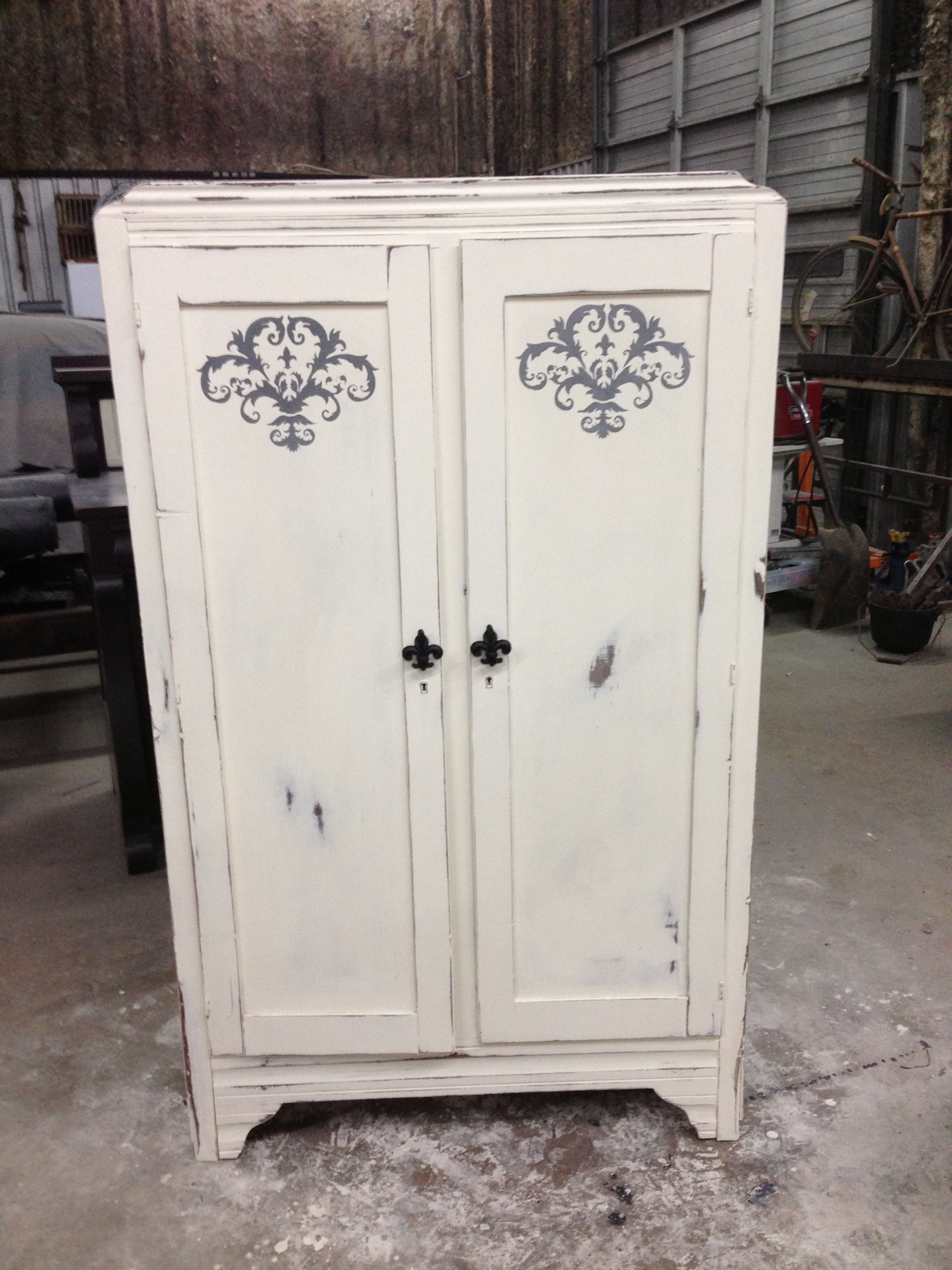 Old armoire repurposed into a pantry painted old white with